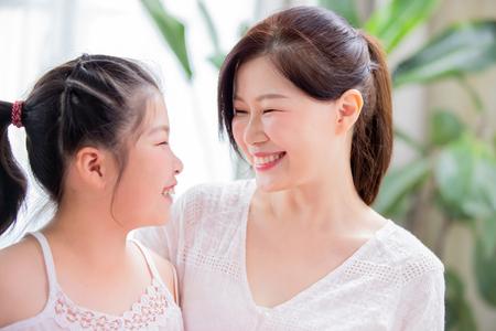 Foto für Mom and daughter gaze toghether and smile tenderly - Lizenzfreies Bild
