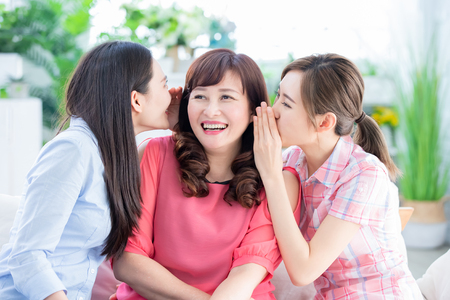 Photo pour two daughters talk to her mother happily at home - image libre de droit