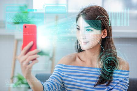 Photo pour face recognition concept - Asian girl use biometric access by smartphone - image libre de droit