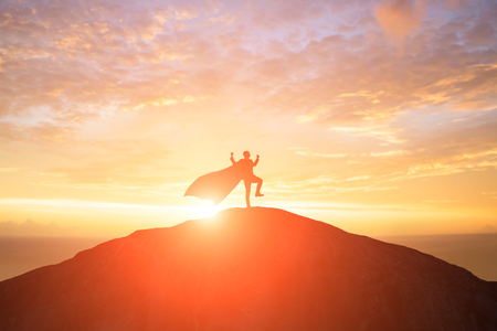 Photo pour silhouette of super businessman with cape feel excited on the mountain in the sunset - image libre de droit