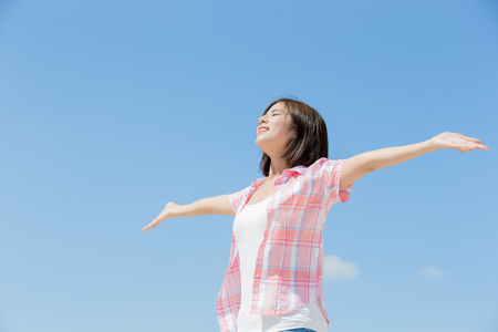 Photo for asian girl feel happy and enjoy nature with sky background - Royalty Free Image