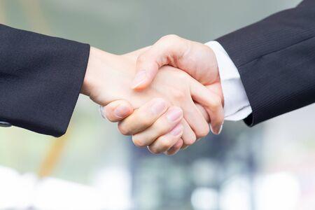 Photo pour Closeup of Businesspeople shake hand after a meeting - image libre de droit