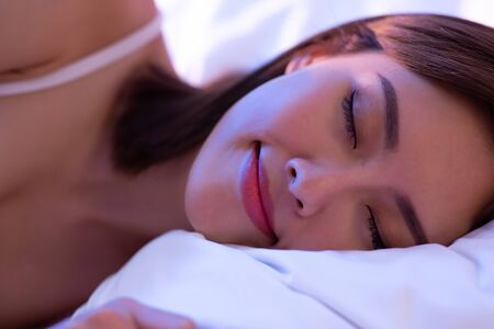 beauty asian woman has a good sleep on the bed at night