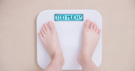 Photo for Lose weight concept with woman on a scale shows too much - Royalty Free Image