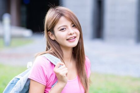 Photo for asian college student smile to you on the campus - Royalty Free Image