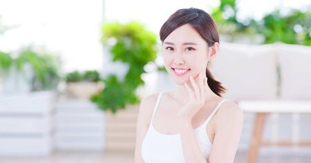 Photo pour Smiling asian woman enjoying the skin care and smile to you - image libre de droit