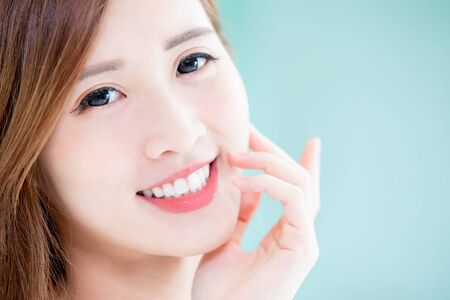 Photo pour close up of beauty skin care woman touch her face and smile to you at home - image libre de droit