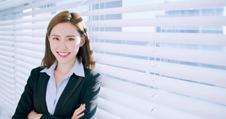 Foto de confident asian business woman smile to you in the office - Imagen libre de derechos