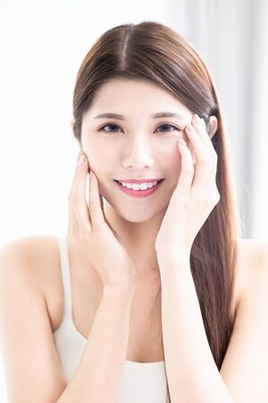 Photo pour young asian skin care beauty touch her face and look to you with smile - image libre de droit