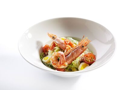 Photo pour Delicious caesar with argentinian shrimps closeup. North american cuisine restaurant dish, menu item. Tasty salad with natural seafood isolated on white background. Organic lunch, healthy food - image libre de droit