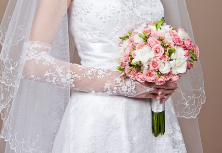 Bride holding a beautiful wedding bouquet of flowers