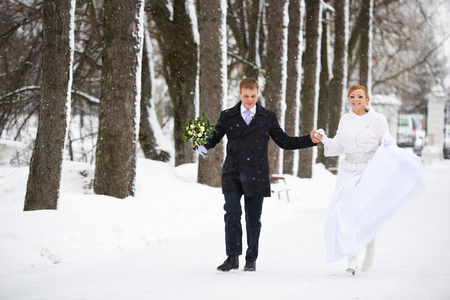 Groovy Happy Bride And Groom Running In Winter Park On Wedding Day Download Free Architecture Designs Scobabritishbridgeorg