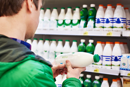 Man shopping milk in grocery store