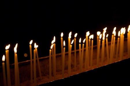 Candles in the Holy Sepulchre on Mount Calvary, Jerusalem, Israel