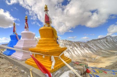 buddhist stupa at the top of barren hills