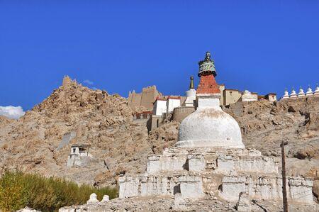 close up of Buddhist stupa against blue sky