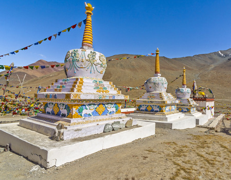 colorful Buddhist stupa in barren landscape of Spiti, India