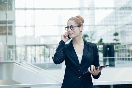 Photo pour Businesswoman using a mobile phone - image libre de droit