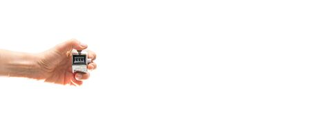 Photo for Left hand holding tally counter with text space - Royalty Free Image
