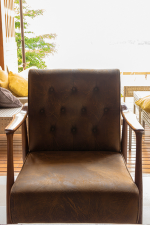 Leather chairs for relaxing on the terrace overlooking the river.in Public club