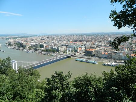 A photo of the famous lanchid  bridge with chains from Budapest taken from the top of Gellert Hill.