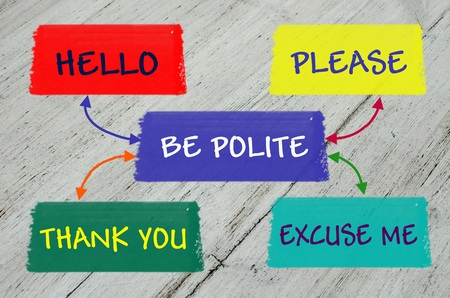 Be polite message over grey wooden background