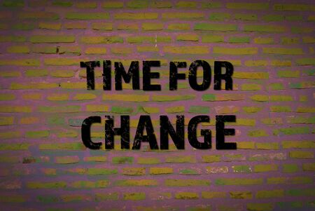 Time for change motivational message on painted brick wall