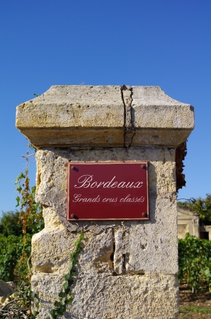 Street sign  grand crus classes, with wine in background  Bordeaux, Gironde, France