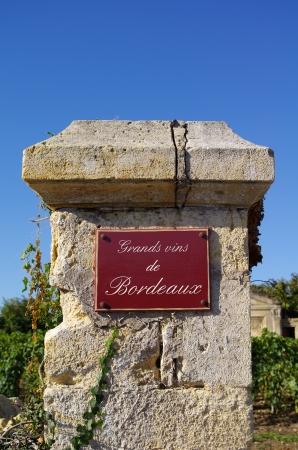 Street sign  grands vin de bordeaux  with wine in background  Bordeaux, Gironde, France