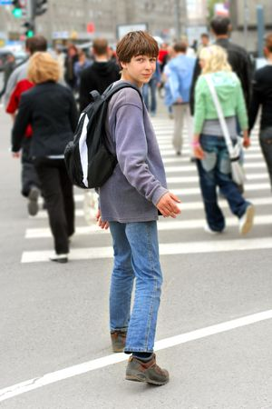 teenager stop on the zebra crossing