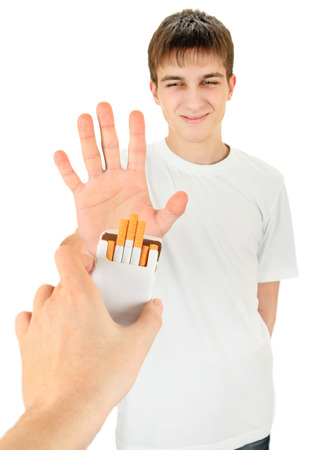 Teenager refuse Cigarettes Isolated on the White Background