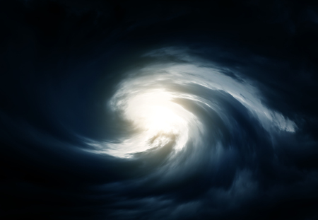 Blurred Swirl in the Dark Storm Clouds with Ray of the Light