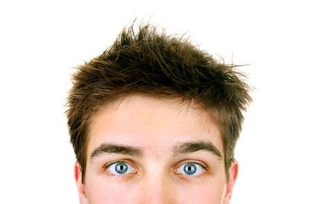 Photo pour Surprised Young Man Face Closeup on the White Background - image libre de droit