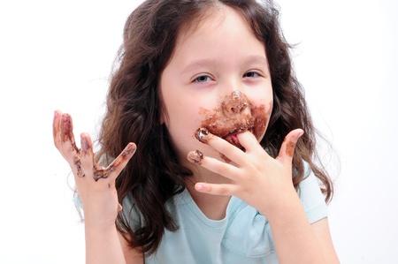 child eat chocolate