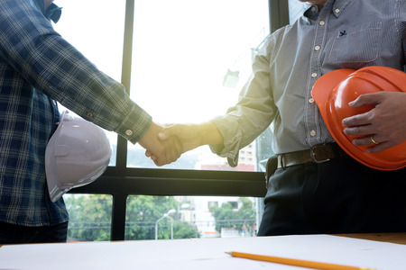 Photo pour Architect or engineer hand shake in concept of success  agreement work - image libre de droit