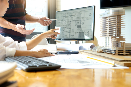 Foto de engineer or architectural project, two engineering or architecture discussing and working on blueprint with architect equipment, Construction concept. - Imagen libre de derechos