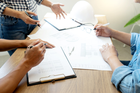 Foto de Group of engineering or architect discussing and working on blueprint with architect equipment, Construction engineer or architectural project  concept. - Imagen libre de derechos