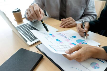Photo pour In office businessman in meeting analyses chart graphy marketing plan in business financial  audit project. Or Business adviser analyzing Budget, - image libre de droit