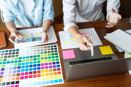 Photo for Group of young designer working in the office to design a new product, use color chart and computer laptop for new smartphone design concept - Royalty Free Image