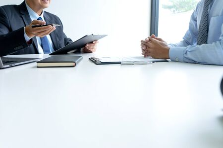 Photo pour Businessman group in office, young asian people sit and speaking with resume while interviewing as candidate for job in big company. career and recruitment concept - image libre de droit