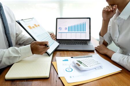 Photo pour business team in casual style have small meeting in the office talk about  analyses chart graph marketing plan with computer laptop calculator. - image libre de droit