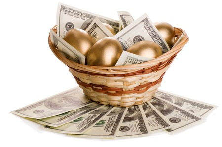 Photo pour golden eggs and dollars in a basket isolated on white background - image libre de droit