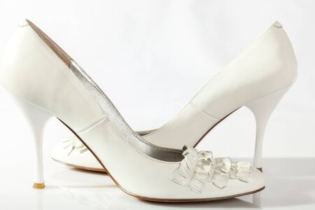 a pair of white shoes on a white background. close-up