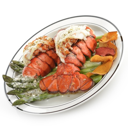 Grilled Lobster Tail Served With Asparagus On White Background