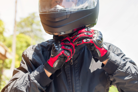 Photo for Man in a Motorcycle with helmet and gloves is an important protective clothing for motorcycling throttle control,safety concept  - Royalty Free Image