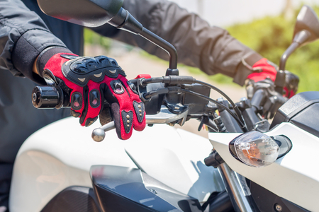 Man in a Motorcycle with gloves is an important protective clothing for motorcycling throttle control,safety concept
