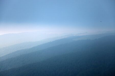Photo pour Flowing clouds closeup on mountains - image libre de droit