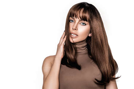 Photo pour Brunette girl with long and shiny hair and bangs. Beautiful model with straight hairstyle and natural beauty face. Hair model concept - image libre de droit