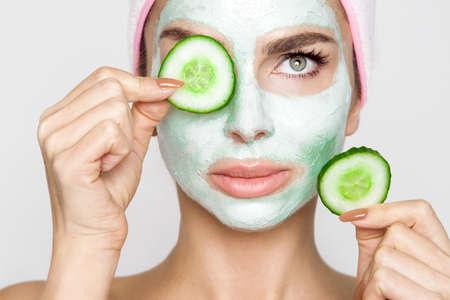 Photo pour Beautiful blonde woman with moisturized face mask. Beauty spa. Skincare concept. Woman with facial mask. - image libre de droit