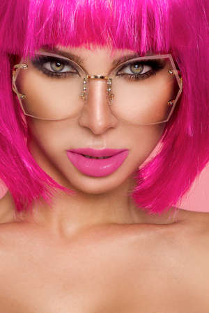 Photo for Beauty girl portrait with colorful makeup, hair, nail polish and accessories. Colorful pastel studio shot of stylish woman. Vivid colors. Makeup and hairstyle. - Royalty Free Image